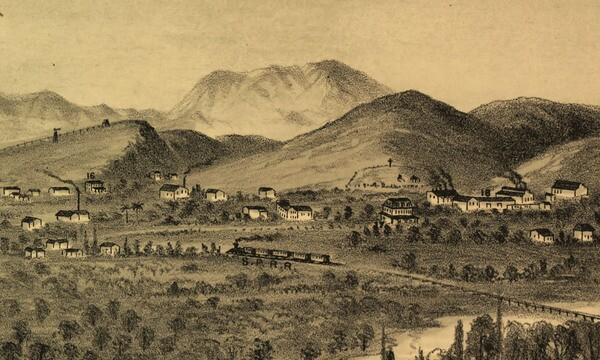 Mount Lookout appears as the prominent hill on the right in this 1877 lithograph of Los Angeles, drawn from Boyle Heights. Behind it rises Cahuenga Peak and the hills of present-day Griffith Park. Courtesy of the Library of Congress.