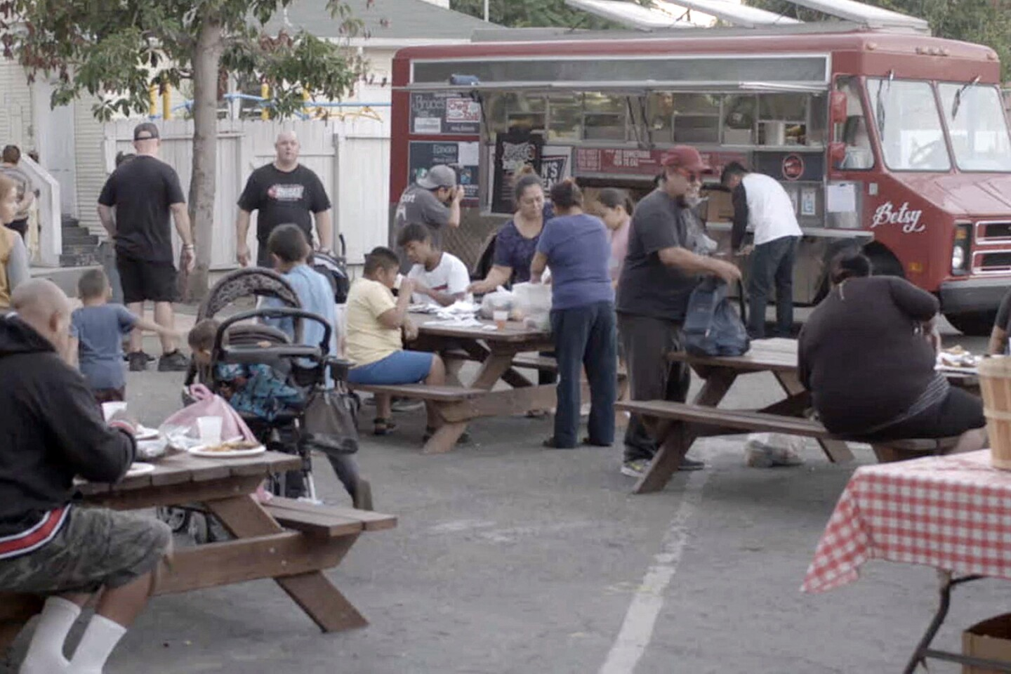 "Serving food from Bracken's Kitchen | Still from ""Broken Bread"""