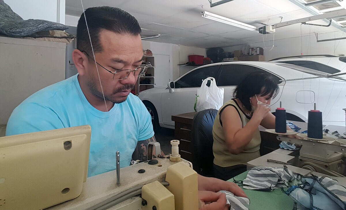Uncle Van Huynh sews masks for the Auntie Sewing Squad with his mom. | Sam Huynh