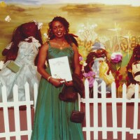 Artist Teresa Tolliver and her installation at a William Grant Still Art Center Black Doll Show, circa 87-90 | Bobbie Campbell, Courtesy of William Grant Still Art Center