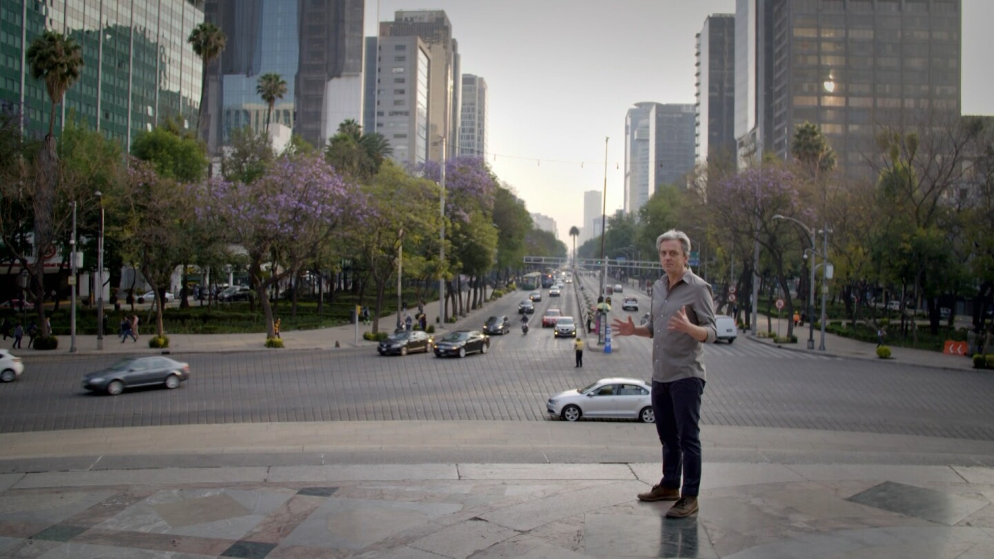"""Life-Sized City"" host Mikael Colville-Andersen stands before a city intersection in Mexico City. 