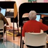 Two people use new voting systems to submit their ballots in L.A. County   Courtesy Los Angeles County Registrar-Recorder/County Clerk