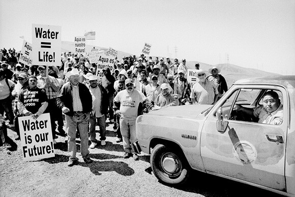 Protesters stopped by a security guard. Mendota, California. The Dispossession | Photo: Matt Black