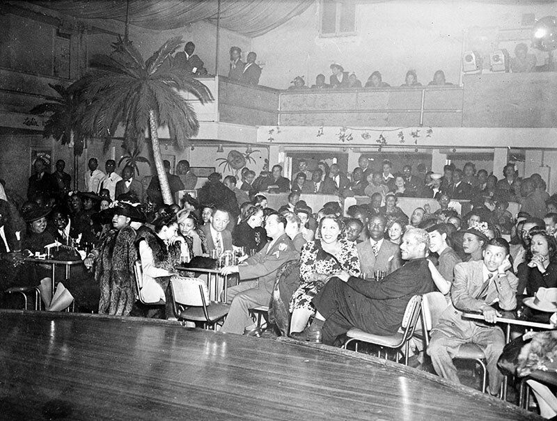 Audience watching a performance at Club Alabam, S. Central Avenue and 42nd Street, 1945. Identified are: actress Lillian Randolph (right of center), dancer Prince Spencer, Clarence Moore, Tillie Culison, Clehue McGee.