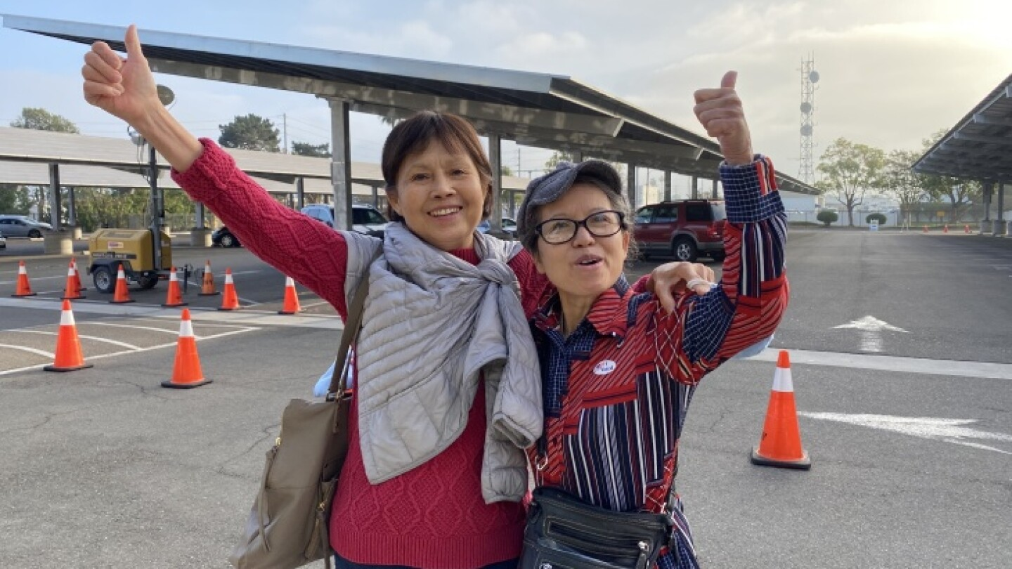 Trinh Luu (left) from Tustin and her sister, Anh Luu (right) from Stanton, arrived at the Orange County Registrar's office this morning at 6:30 a.m.   Jill Replogle/LAist