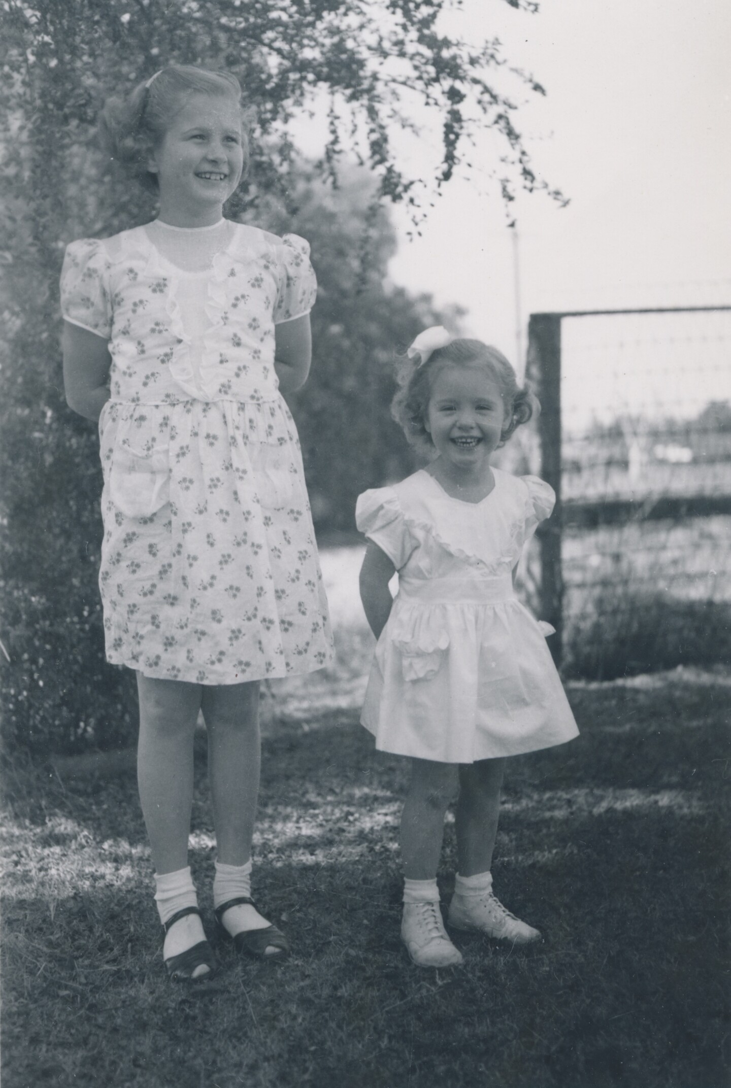 Before her death, three-year-old Kathy Fiscus (right) smiles next to her older sister Barbara (left) for a photo.