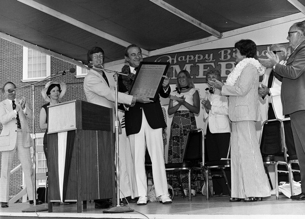 Carl's Jr. founder Carl Karcher holds a copy of the Declaration of Independence at Knott's Berry Farm's 1976 bicentennial celebration. Courtesy of the Orange County Archives.