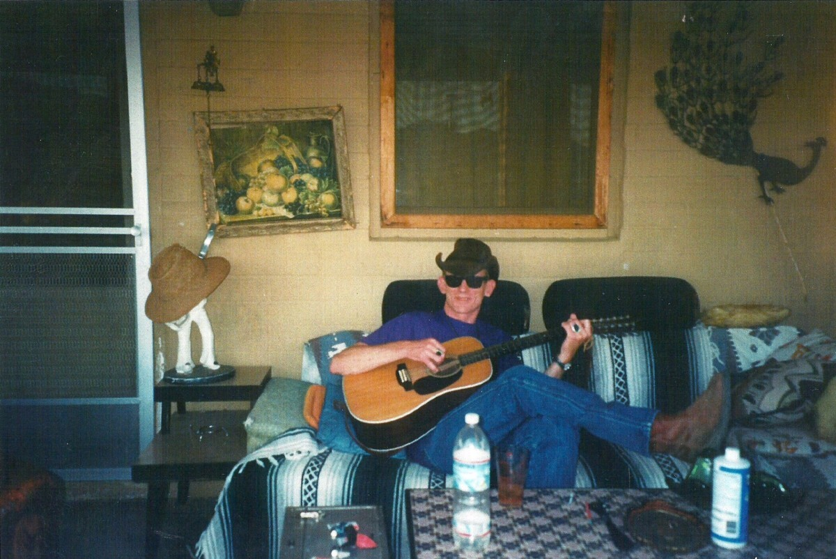 Fred Drake playing guitar on the front porch of Rancho de la Luna. | Courtesy of Chrissie  JT Wilson.