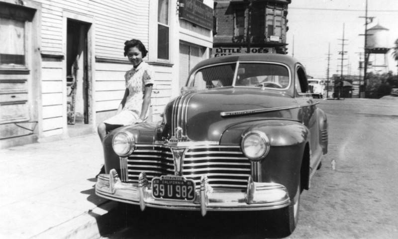 Woman poses with a car