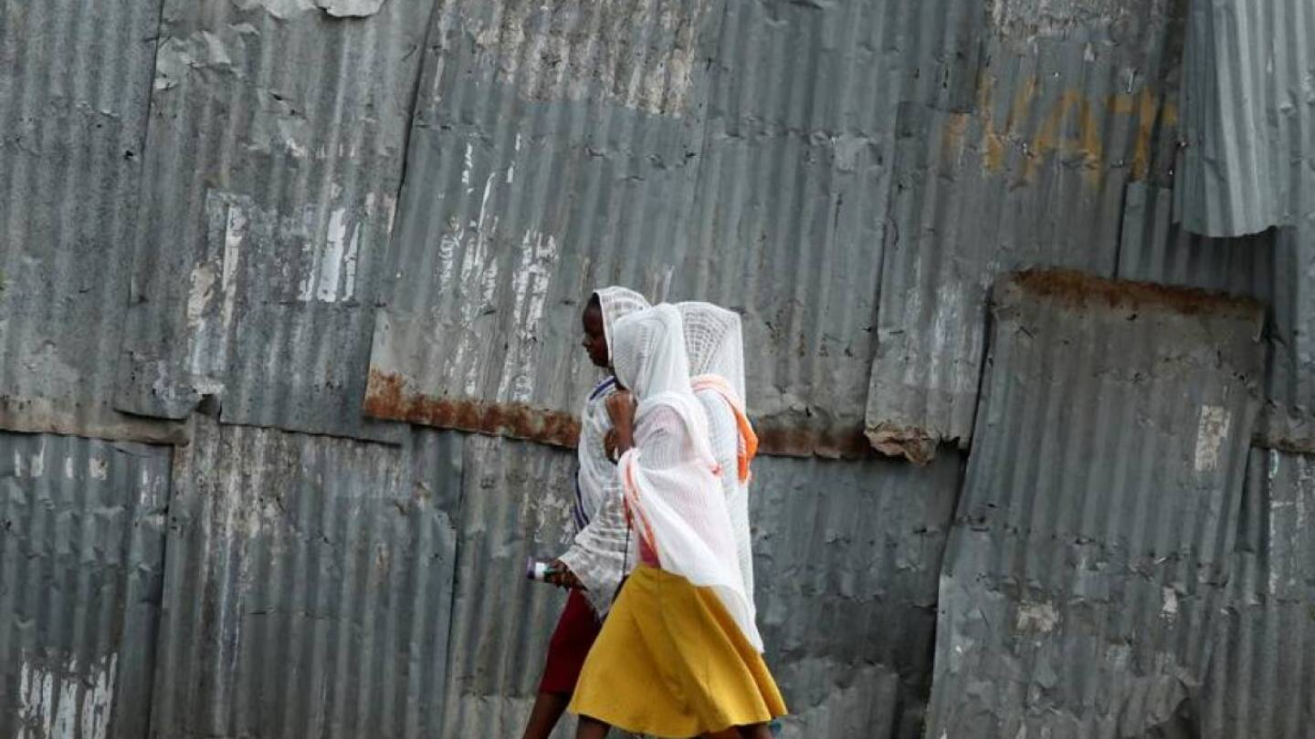 FILE PHOTO: Orthodox women walk along the street to attend a Friday evening prayer in Hawassa, Ethiopia, November 22, 2019. | REUTERS/Tiksa Negeri