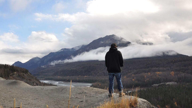 A man stands at an overlook.