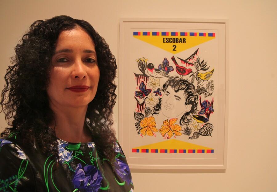 "Carolyn Castaño and her work. ""Escobar 4,"" 2013. | Photo: Drew Tewksbury."