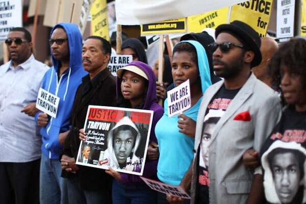 People walk in a silent protest march to demand justice for the shooting of Trayvon Martin, on April 9, 2012 in Los Angeles, California. Photo by David McNew/Getty Images