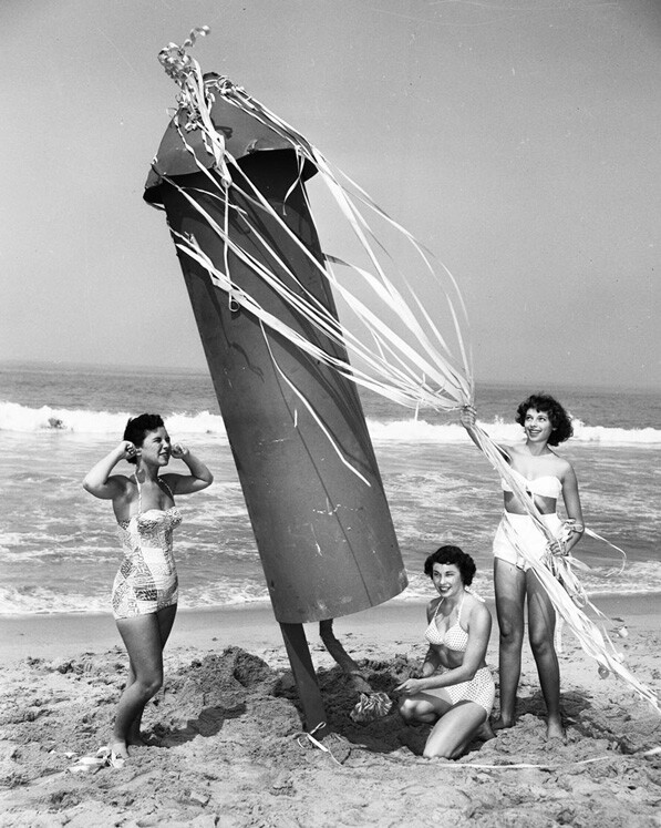 Women play with a giant explosive on Ocean Park Beach to promote the beach's 1952 Independence Day festivities.