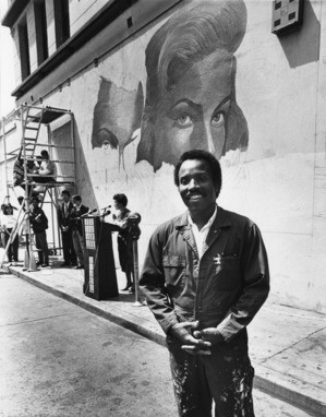 Wyatt working on a mural on Hollywood Boulevard, 1989 | Herald-Examiner Collection, Los Angeles Public Library