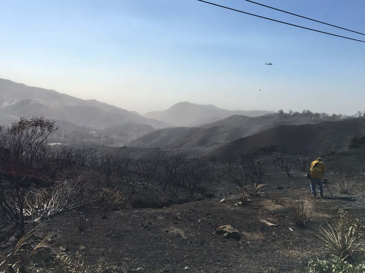 A camerman (Dennis Nishi) captures the aftermath of the Woolsey Fire. Shot by Tori Edgar.