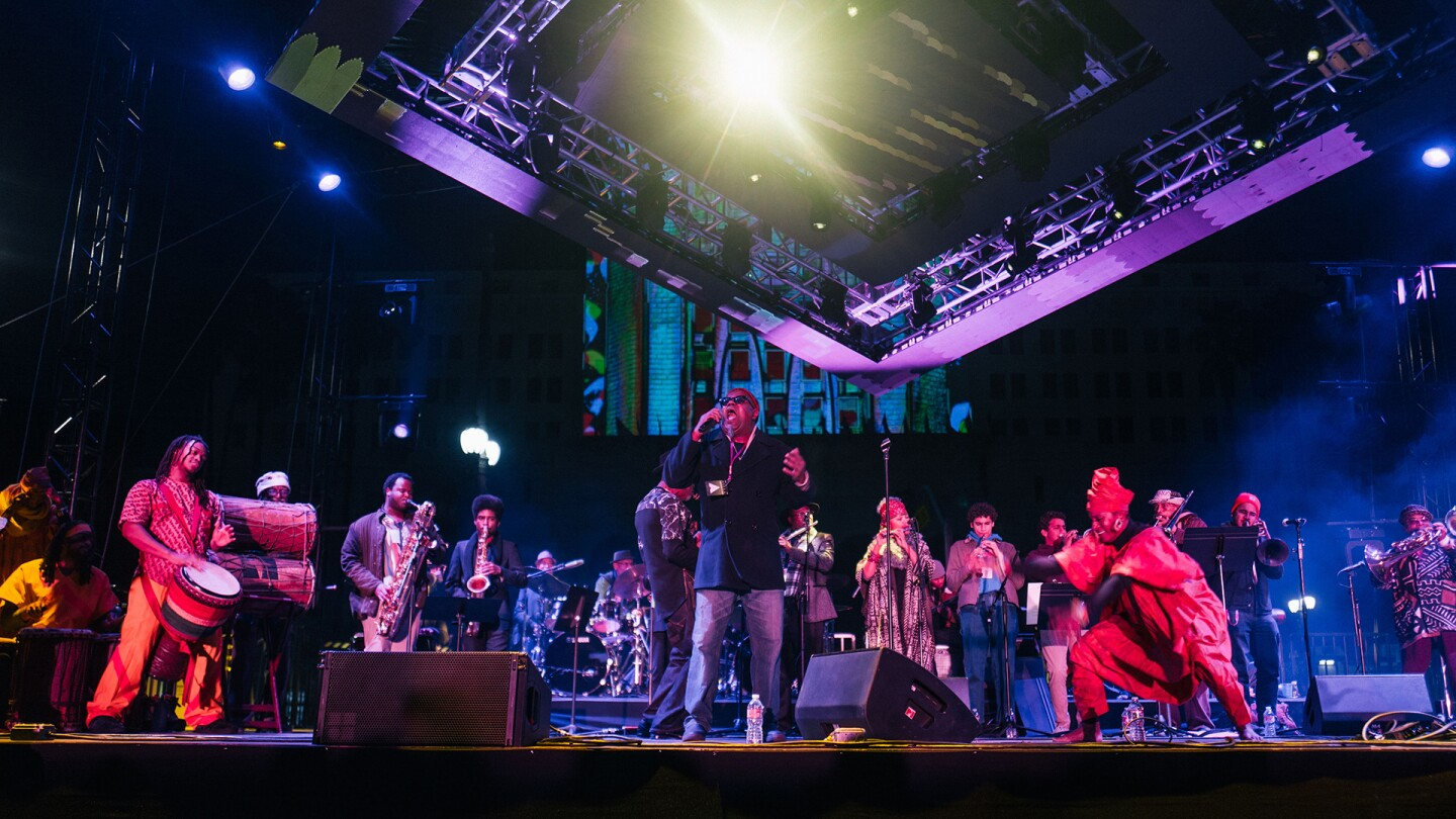 Pan Afrikan Peoples Arkestra on stage at Grand Park during a New Year's Eve celebration | Samantha Lee sls ep9 preview