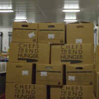 "Boxes of recovered food donated by restaurants and hotels to Chefs to End Hunger. | Still from ""Broken Bread"""