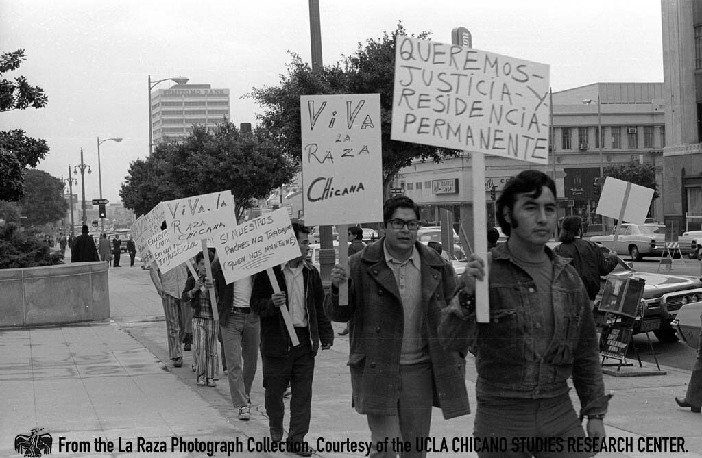 CSRC_LaRaza_B13F4S2_N003 People outside the state building during a Center for Autonomous Social Action demonstration | Pedro Arias, La Raza photograph collection. Courtesy of UCLA Chicano Studies Research Center