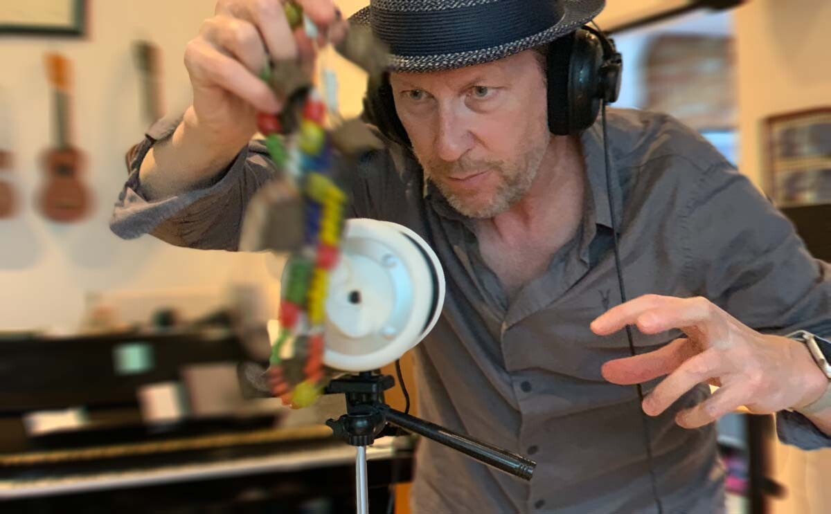 Rolfe Kent works on recording sounds for his 360 audio journeys. | Courtesy of Rolfe Kent