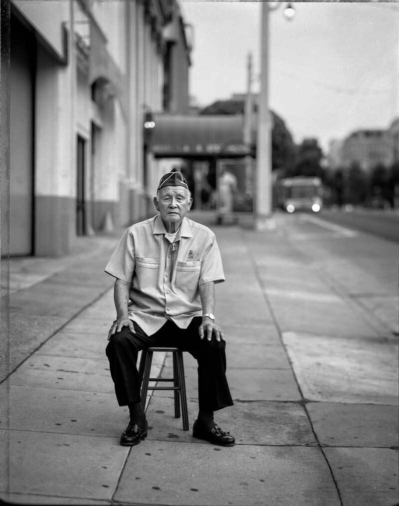 """Mitsunobu """"Mits"""" Kojimoto, 85, outside the building on Van Ness Avenue in San Francisco where he waited for a bus to take him to the Santa Anita Assembly Center in 1942.   Paul Kitakagi, Jr."""