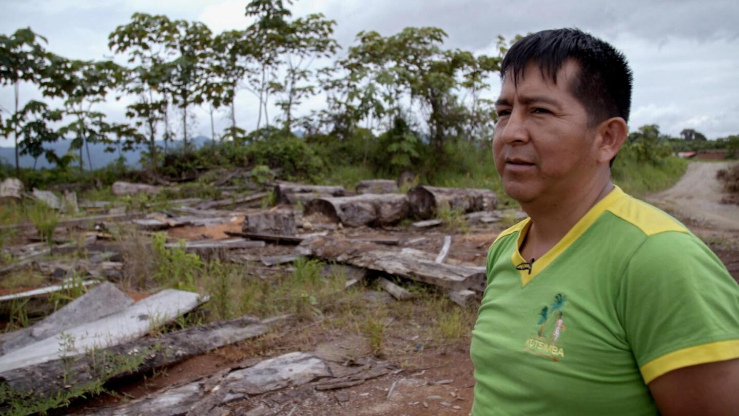 "Luis Navarro, president of the Kotsimba Indigenous community in Peru, walking through his tribe's land in Peru. | Still from ""Earth Focus"""