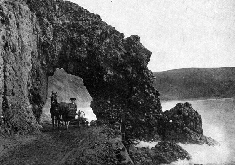 A primitive wagon road, shown here at Arch Rock, connected Santa Monica to the Rindge ranch before construction of the Roosevelt Highway. Courtesy of the Photo Collection, Los Angeles Public Library.