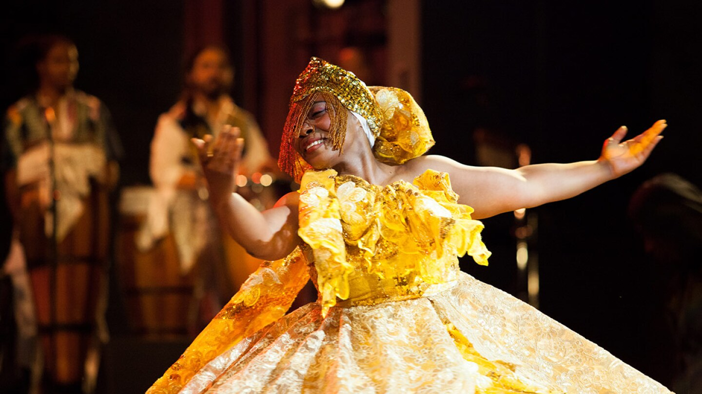A Viver Brasil dancer in resplendent yellow dress | Courtesy of Viver Brasil