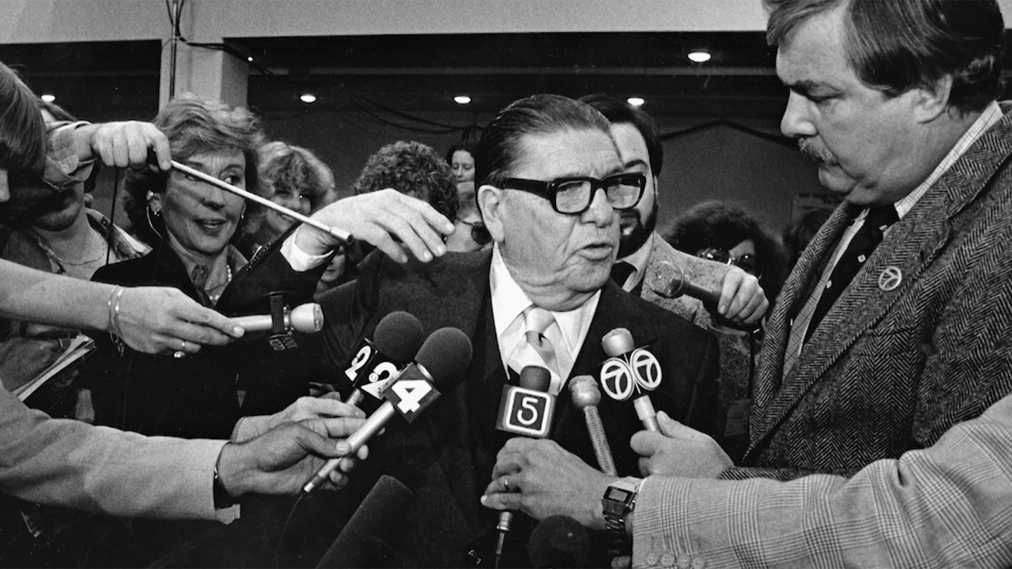 """Howard Jarvis speaking to a crowd of reporters 
