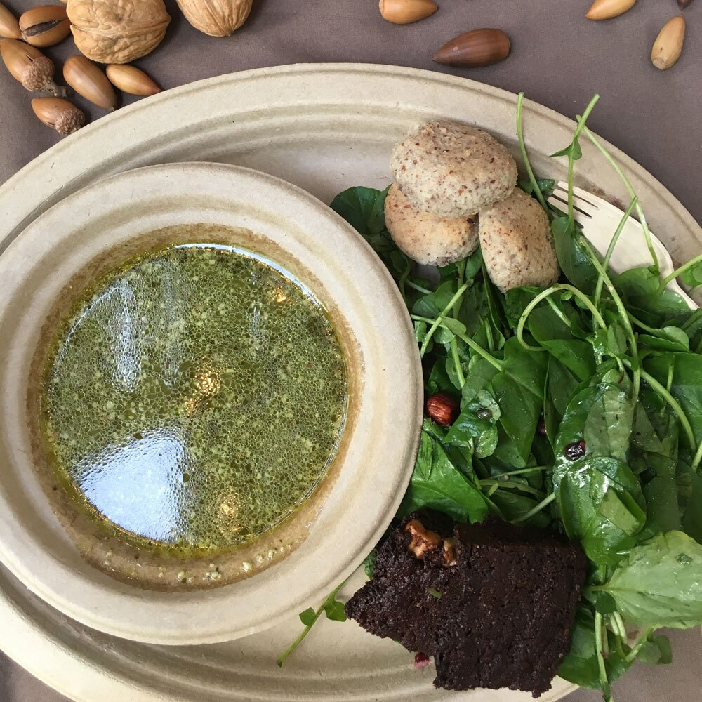 A tasting of a meal at Cafe Ohlone includes acorn flour brownie, a native greens Ohlone salad, bitter greens bisque made with duck fat, and hazelnut flour biscuits. | Momo Chang