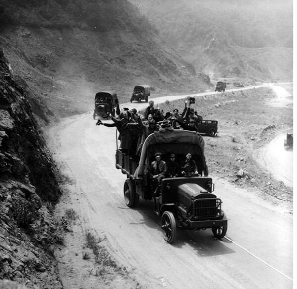 Young men riding in army trucks to go up into the mountains behind Azusa for the purpose of reforestation | Photo Courtesy of the Los Angeles Public Library