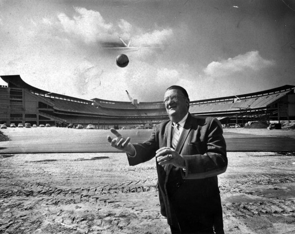 Dodgers president Walter O'Malley in front of a nearly completed Dodger Stadium in 1962. Courtesy of the Photo Collection - Los Angeles Public Library.