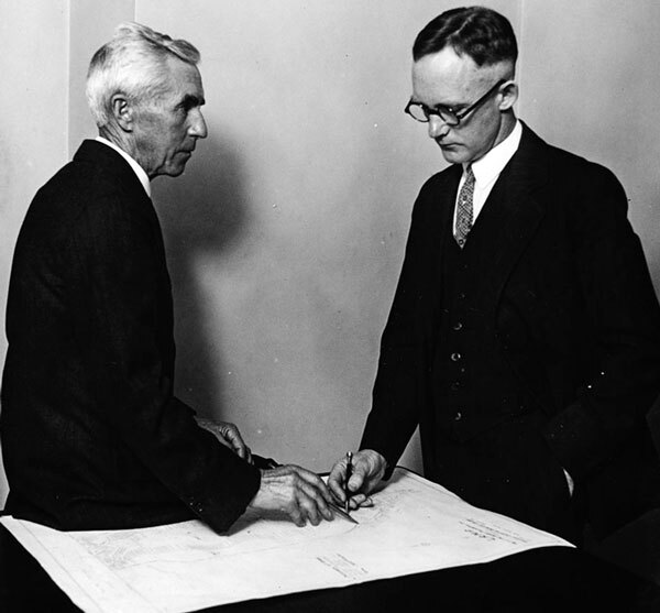 Oakley (left) reviews plans for the California Botanic Garden with botanist E. D. Merrill, the gardens' director. Courtesy of the Los Angeles Area Chamber of Commerce Collection, USC Libraries.