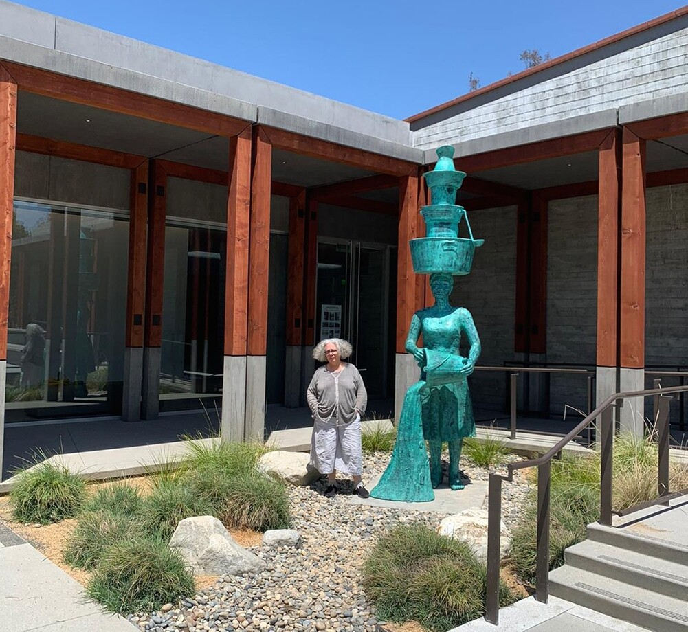 """Alison Saar next to """"Imbue"""" (2020) outside the Benton Museum of Art 