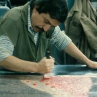 Master printer inking plate at Mixografia, 1979