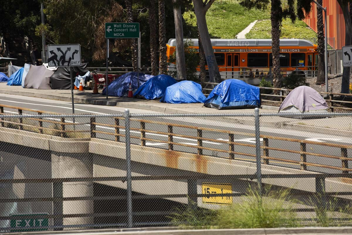 Tents housing homeless over a bridge | iStock