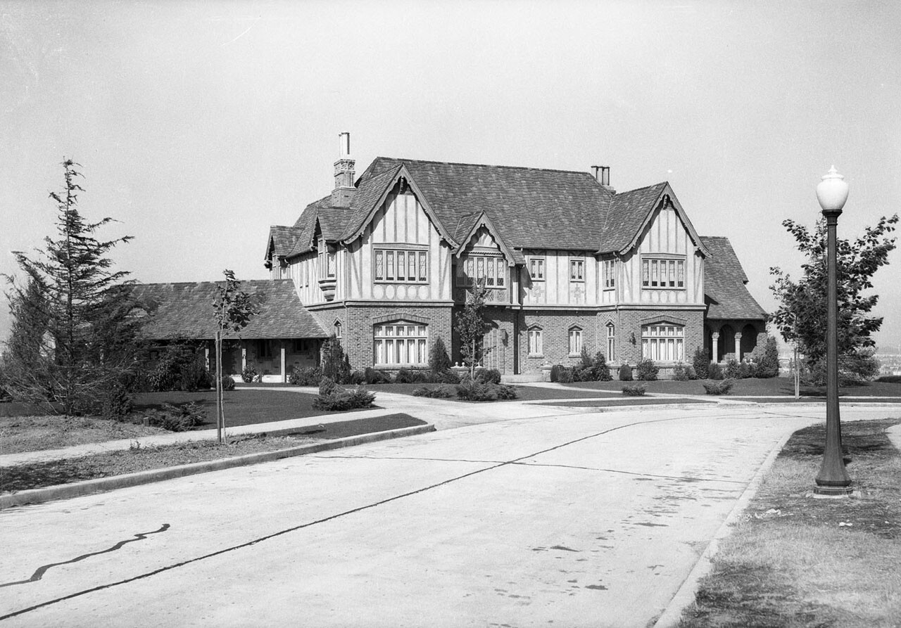 1927 view of Fred W. Forrester's English Tudor house, from which Forrester could see the Standard Oil well in a nearby ravine. Courtesy of the USC Libraries - Dick Whittington Photography Collection.