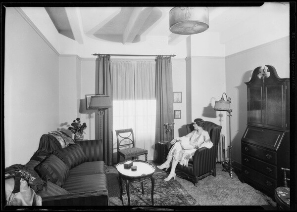 Woman lounging inside one of the guest rooms   Dick Whittington Studio Collection, USC Digital Library