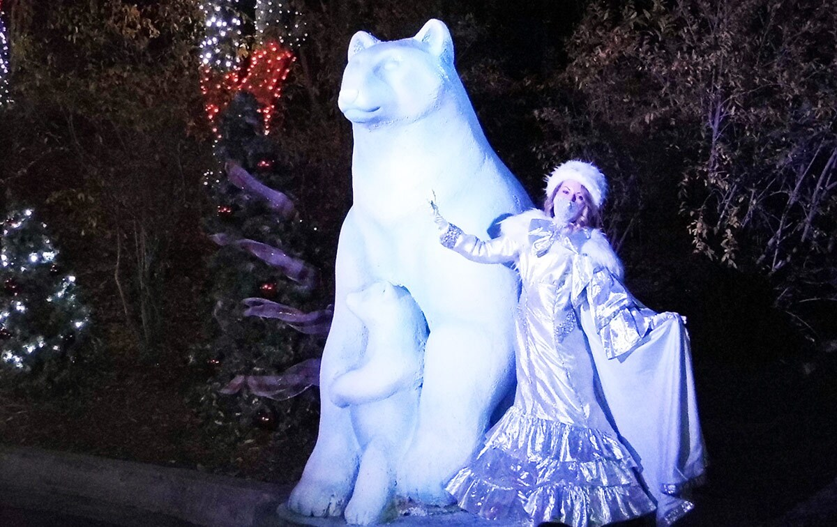 The winter queen poses next to a polar bear sculpture at Holiday in the Park at Six Flags Magic Mountain. | Sandi Hemmerlein