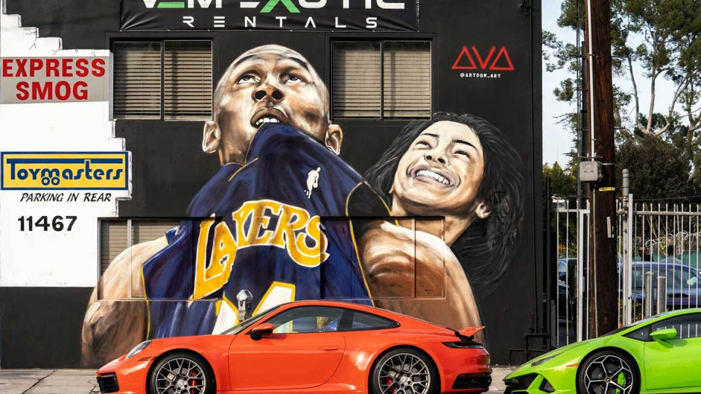 A mural honoring Kobe Bryant and his 13-year-old daughter, Gianna, who died in a helicopter crash along with seven others. The mural was painted by artist Artoon | Ronen Tivony / Echoes Wire/Barcroft Media via Getty Images