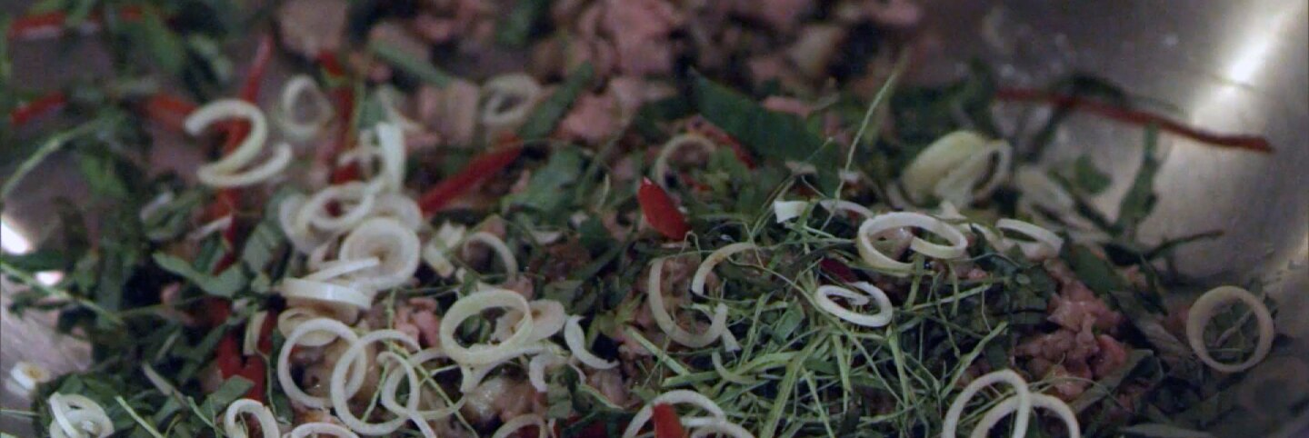 "Ingredients in mixing bowl for larb served at E.P. & L.P. | Still from ""The Migrant Kitchen"""