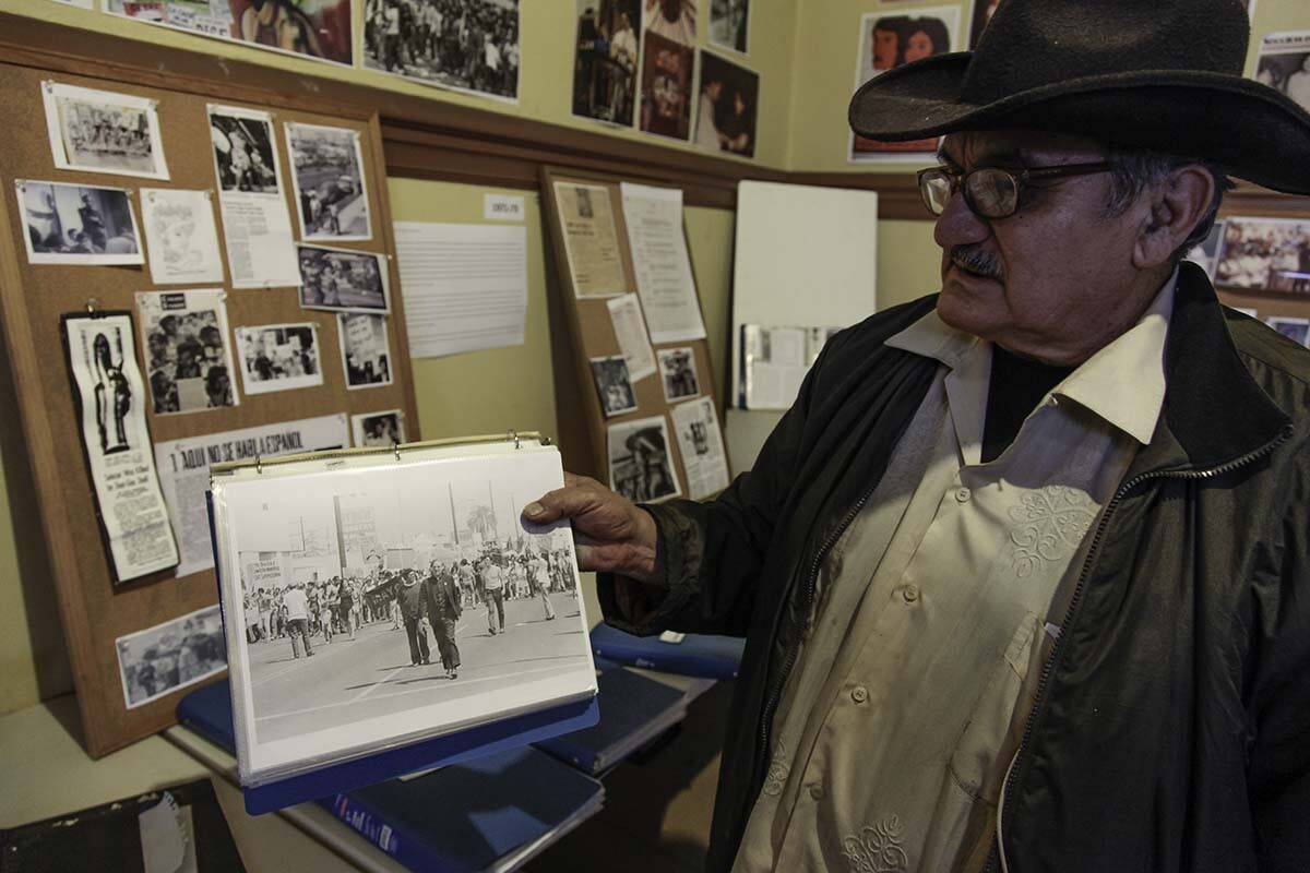 Historian Rosalio Muñoz showing archival photo of Fr. Luce at a protest event | Courtesy of Ravi GuneWardena La Raza AB s9