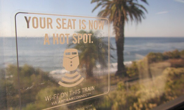 A sticker advertising Amtrak's new wireless internet service aboard the Pacific Surfilner in Santa Barbara County | Photo by Zach Behrens/KCET