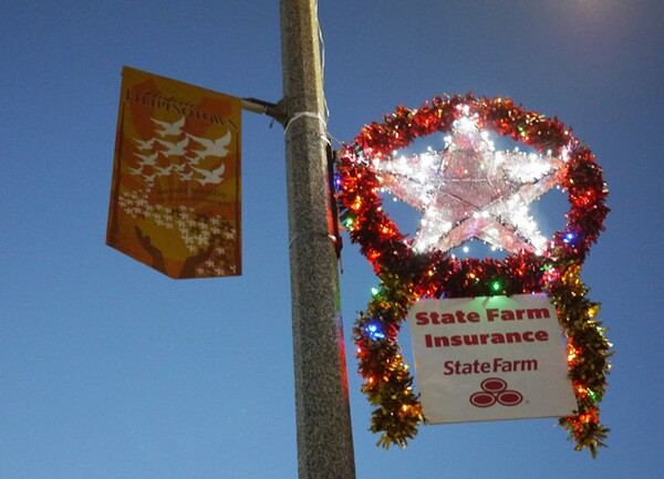 The 31 parols along Temple Street are sponsored by businesses or families.  The parols' lights turn on when the street lights turn on for the night.