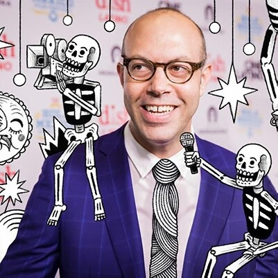 Hola Mexico founder & director Samuel Douek has illustrated skeletons in the photo with him | Courtesy Vesper Public Relations