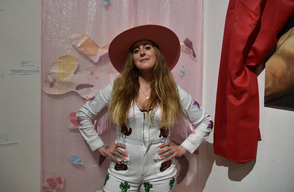 """Molly Simmons poses for a photo at the art show """"Our Right to Thrive"""" in Brooklyn, New York on March 3, 2020.   Handout: SWOP Brooklyn"""