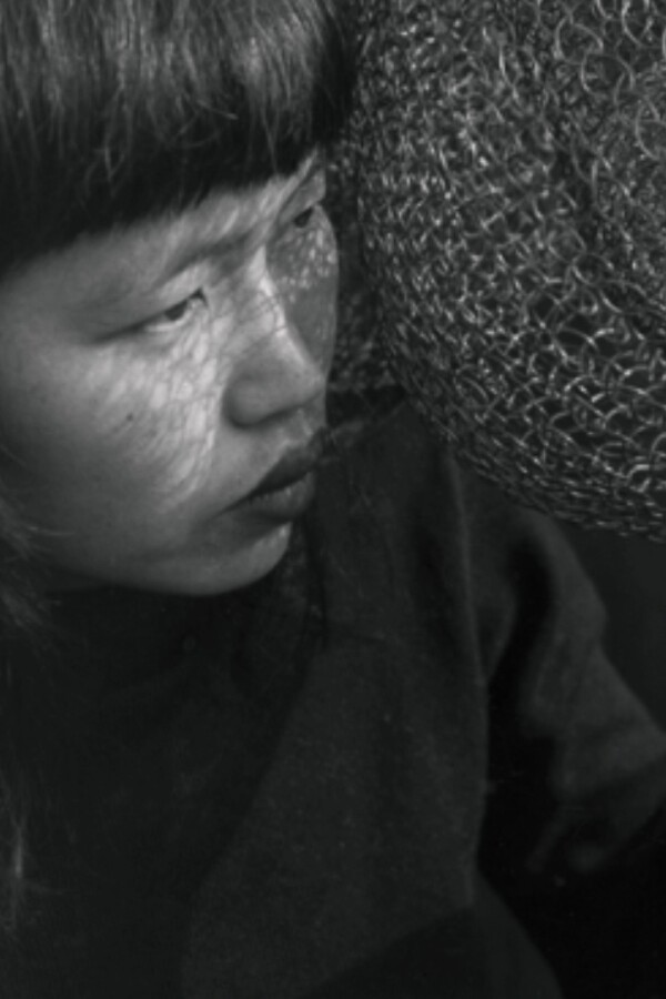"""Ruth Asawa with wire sculpture 