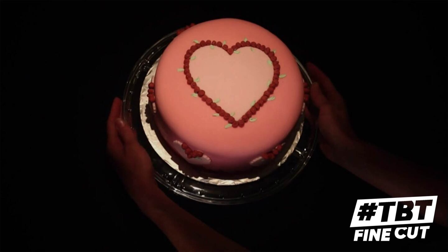 "A birthday cake with a heart design | Still from ""Fine Cut"" American Sweetheart with TBT logo"