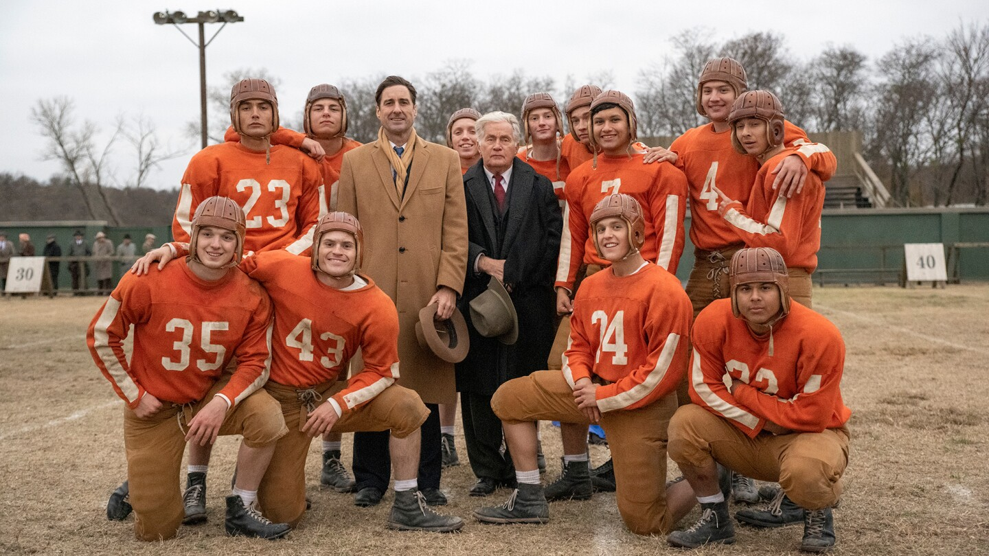 A football team poses for a group photo.