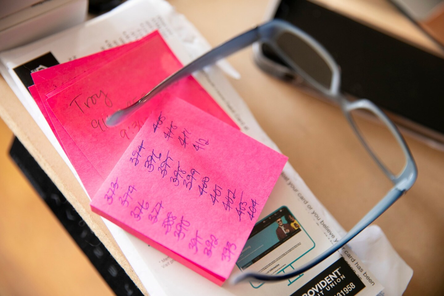 Alyssa Jenkins' keeps track of the over 400 vaccine appointments she made for people on a pink sticky note.